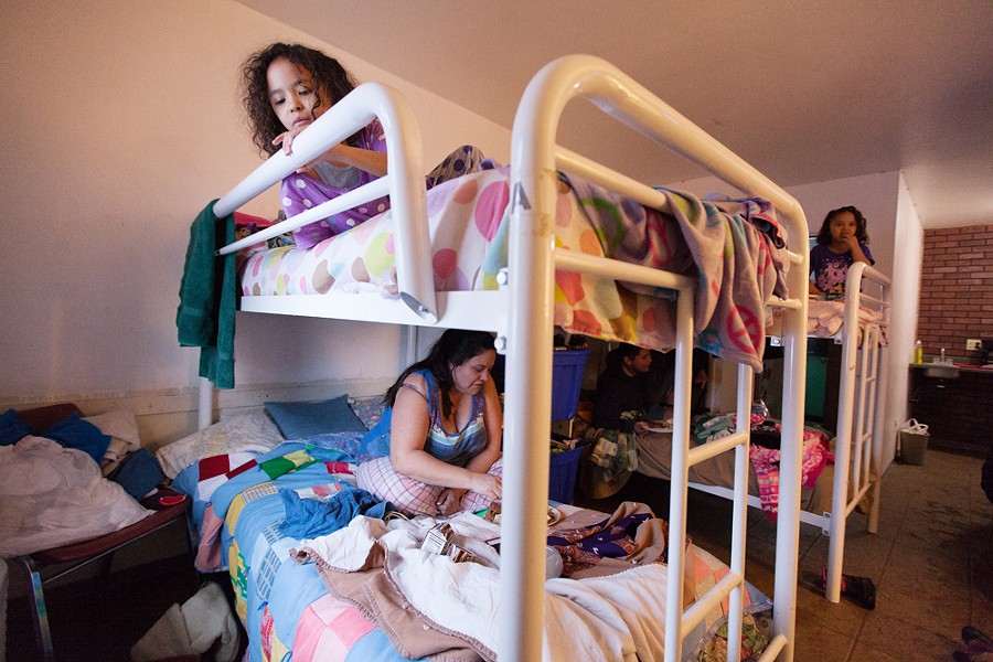 Seven-year-old Savannah Owens, top, and her mother, Elizabeth Vasquez, eat in their room at the Union Gospel Mission Crisis Shelter for Women and Children. - YOUNG KWAK