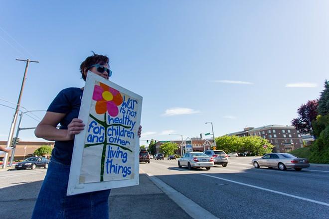 Shar Lichty protests against the threat of bombing Iraq. - MATT WEIGAND