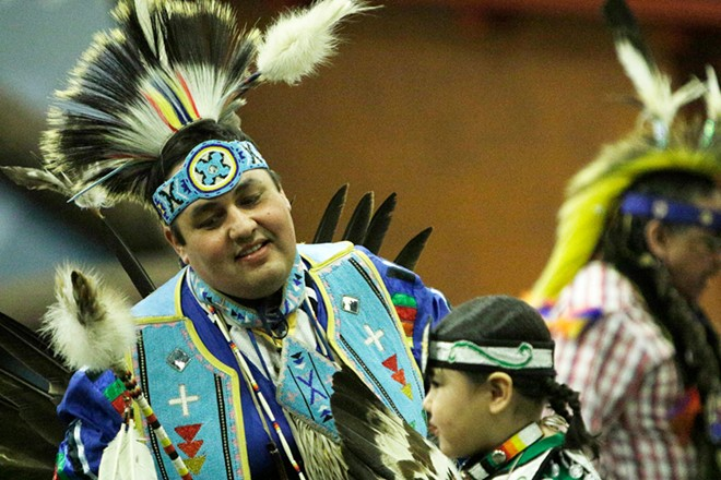Shawn Decker, left, of the Salish and Spokane Tribes, left, and his 6-year-old son Brock dance. - YOUNG KWAK