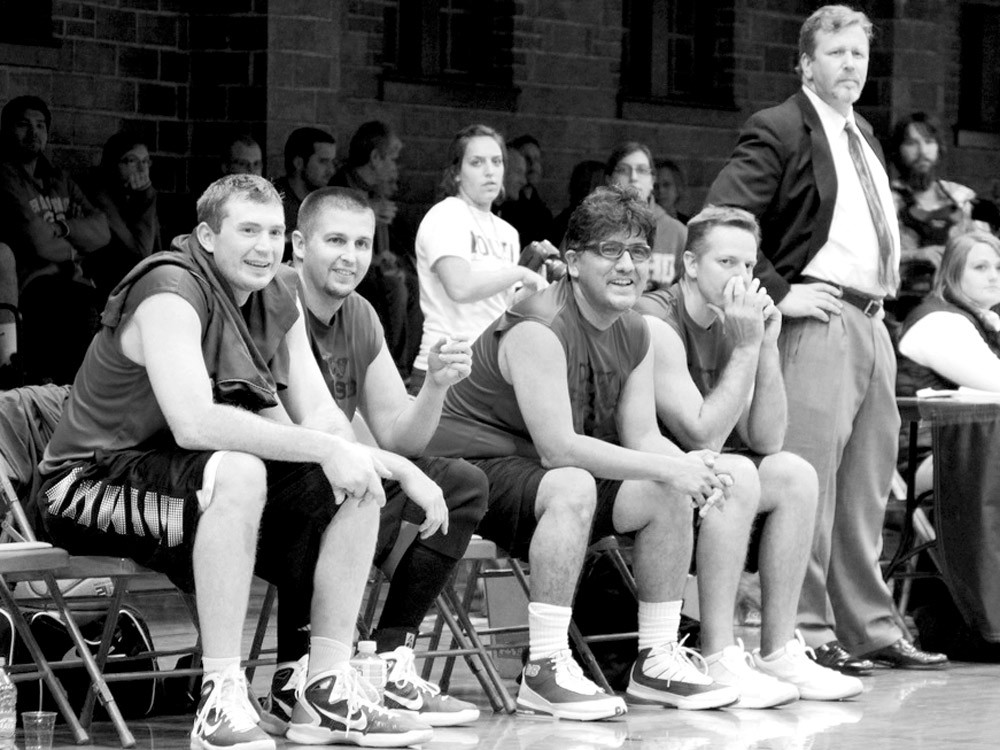 Sherman Alexie and Shann Ray (seated, third and fourth from left) team up with local basketball legends