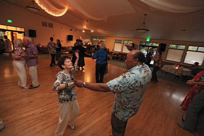 Shirley Harman, left, and Rick Smith dance to music played by Swing Street during the Thursday Night Dance  at the Southside Senior & Community Center on Aug. 8. - YOUNG KWAK