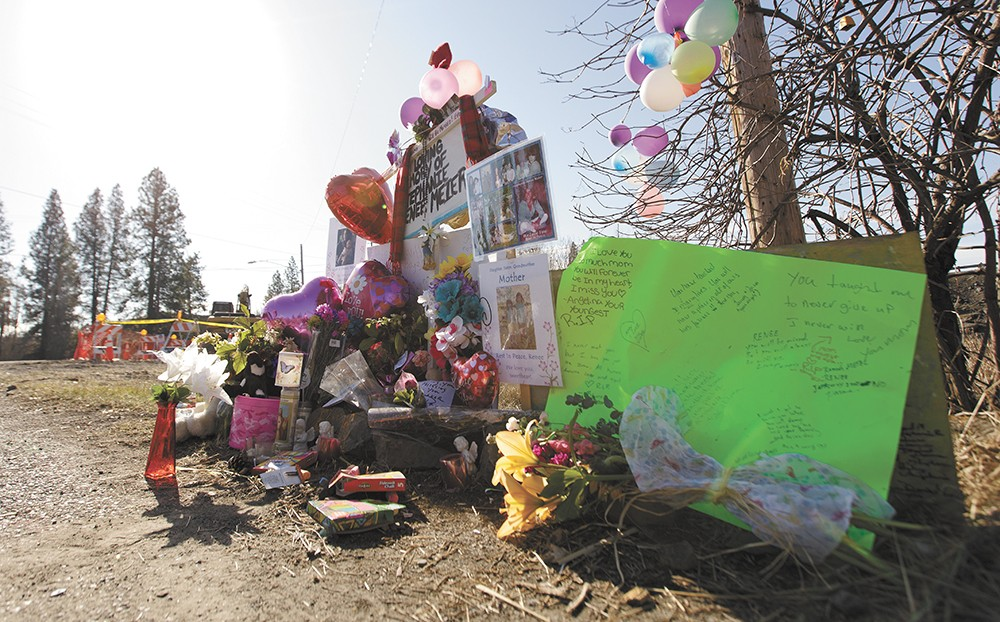 Sidewalk chalk, porcelain angels and stuffed animals — a few Stephanie Renee Meier's favorite things — are placed among flowers and notes left at the accident site. - YOUNG KWAK