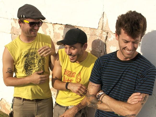 Singer Devin Peralta (right) and Cobra Skulls