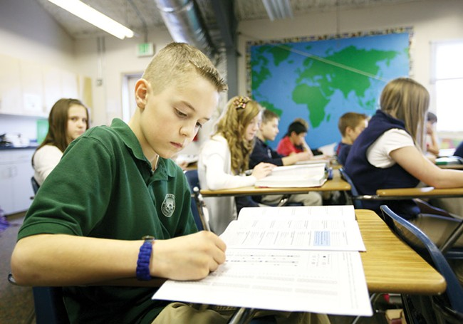 Sixth-grader Cameron takes a National Geography Bee exam during study lab at Coeur d\'Alene Charter Academy. - YOUNG KWAK
