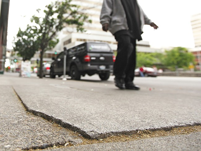 So far this year, the Spokane City Council has approved nearly $200,000 in settlements for sidewalk injuries. - YOUNG KWAK
