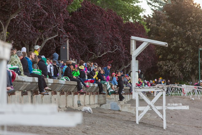 Spectators line City Beach anticipating the start of the Coeur d'Alene Ironman. - MATT WEIGAND