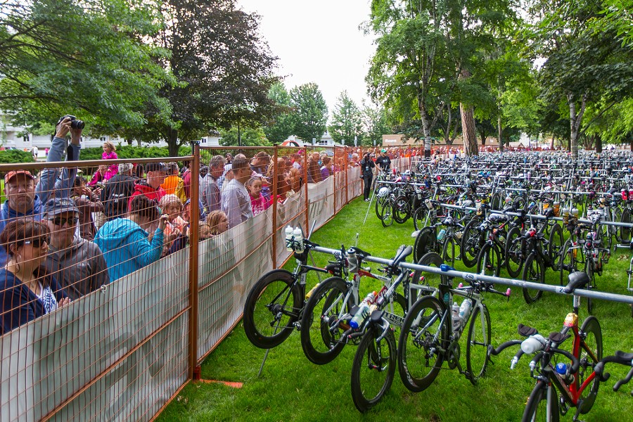 Spectators line the bike area to watch as competitors start the 112-mile bike portion of the triathlon. - MATT WEIGAND