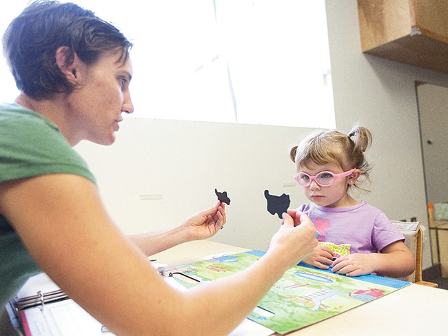 Speech Therapist Jen Wells leads a word exercise with 2-year-old student Abygail at Spokane Guilds\' School. - YOUNG KWAK