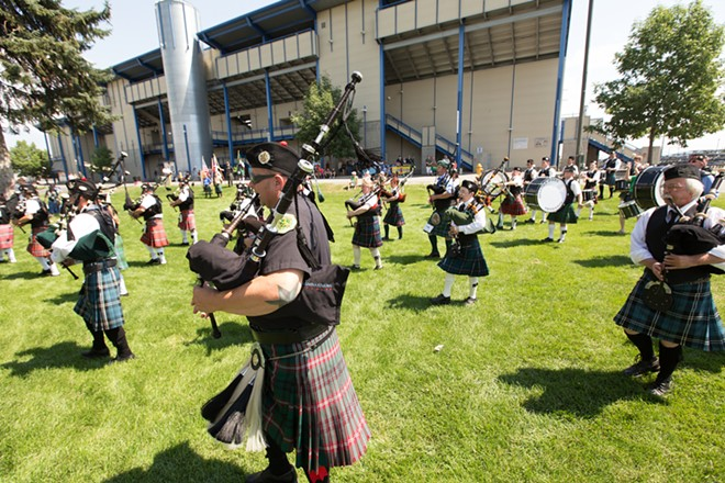 Spokane County Firefighters Pipes & Drums member Nate Brown, front, performs during the opening ceremonies. - YOUNG KWAK