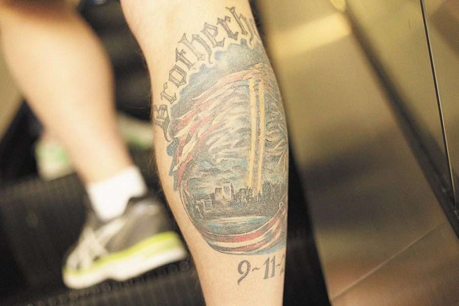Spokane Fire Department Captain Roger Libby's intricate - commemorative 9/11 tattoo on his right calf took three sessions and 20 hours to complete. - YOUNG KWAK