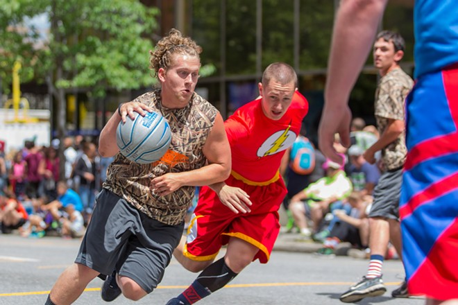Spokane local Aj Avery, left, plays hard with friends from high school and pushes past Alex Steinmetz on Washington Street. - MATT WEIGAND