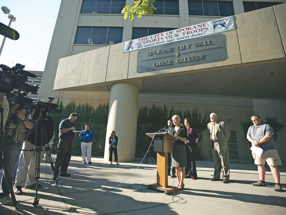 Spokane Mayor Mary Verner at a press briefing last week, flanked by City Council members and members of the press. - YOUNG KWAK