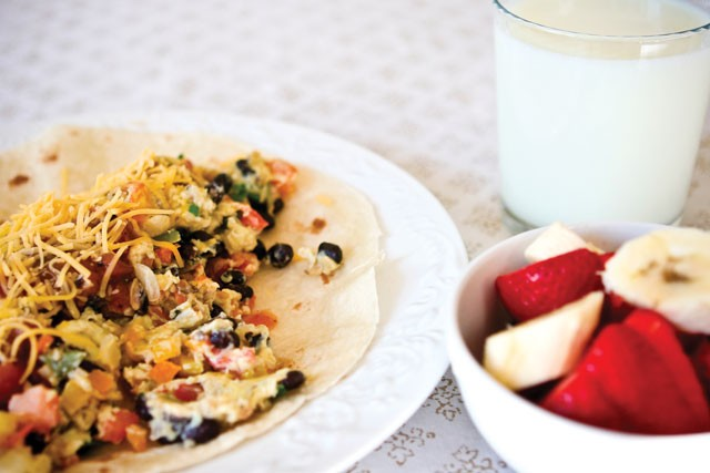 Spokane mom and Meatless Monday practitioner Michelle Sidles makes minus-the-meat look yummy with this breakfast burrito. - MICHELLE SIDLES
