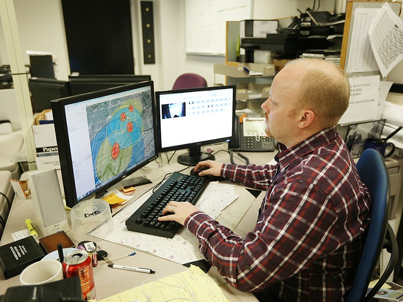 Spokane Police Department Crime Analyst Tom Michaud looks at a crime hot spot map. - YOUNG KWAK