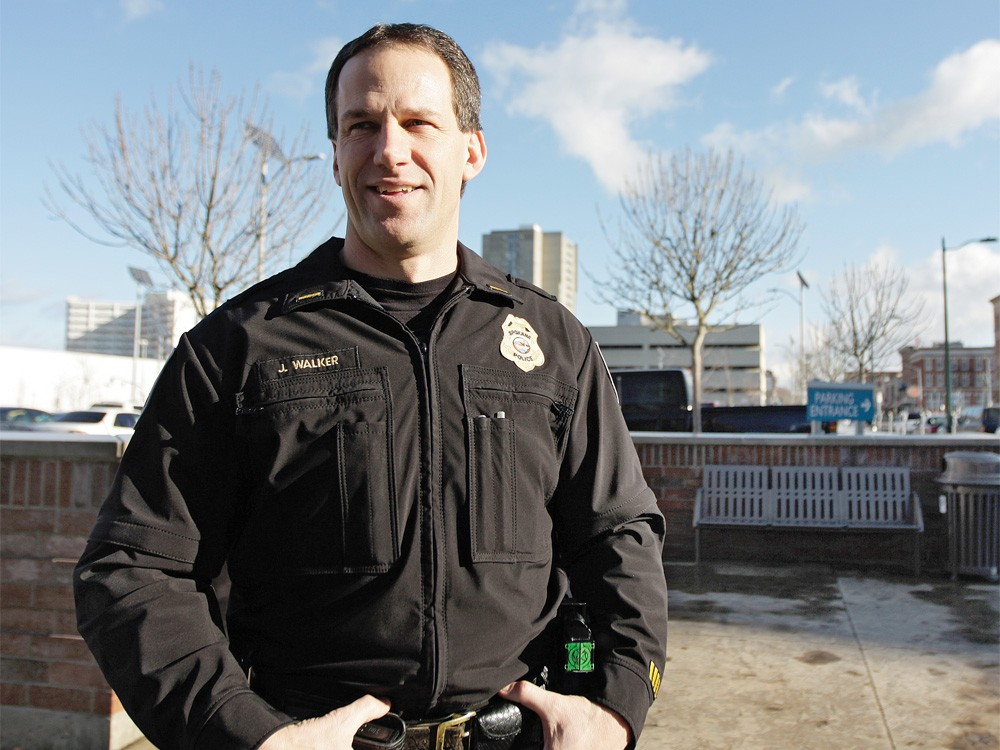 Spokane Police Lt. Joe Walker standing in front of the bench where the backpack bomb was left. - YOUNG KWAK