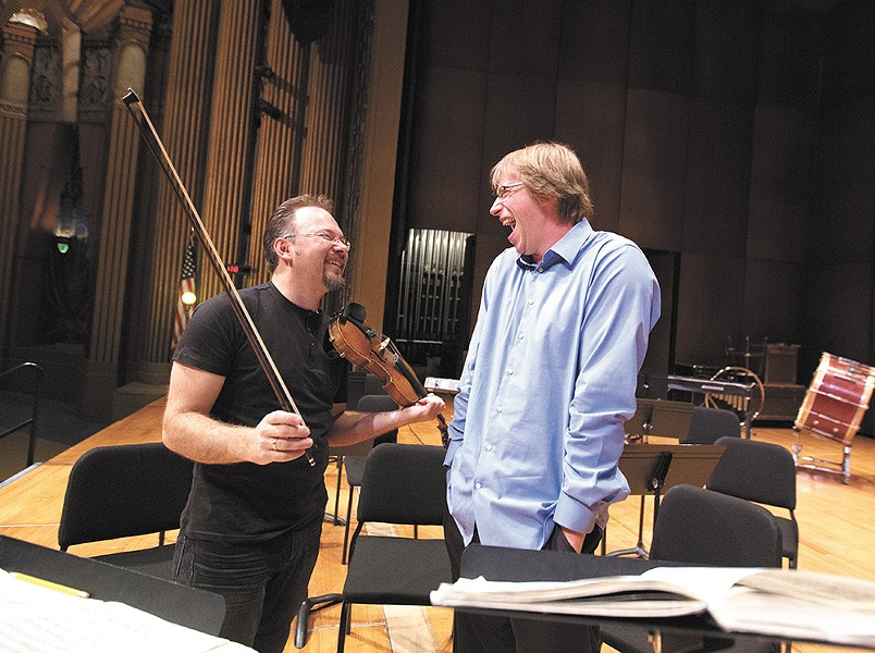 Spokane Symphony concertmaster Mateusz Wolski, left, and Music Director Eckart Preu share a laugh during rehearsals. - YOUNG KWAK
