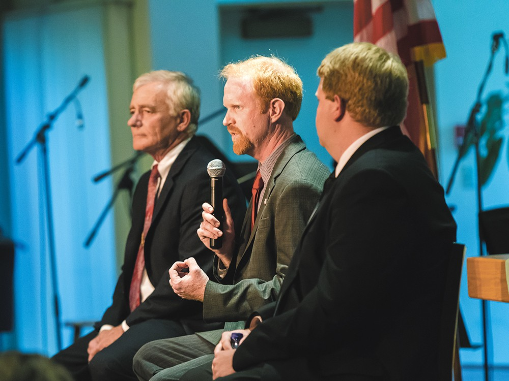 State Sen. John Smith responds to a question at the debate where he faced off with Mike Brunson (left) and Brian Dansel (right). - STEPHEN SCHLANGE