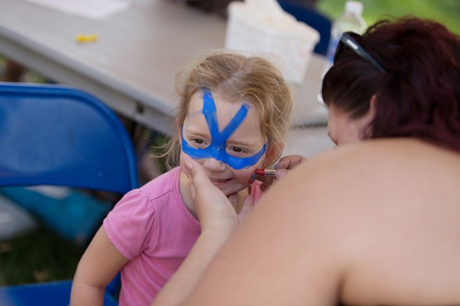 Stephani Henne, right, paints Kiera Mangis' face. - YOUNG KWAK