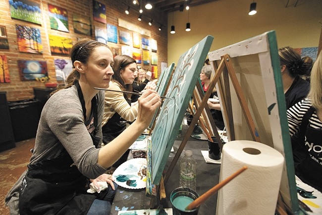 "Student Lisa Mularski works on a painting, ""Jasmine's Jade,"" during a class at Pinot's Palette. - YOUNG KWAK"