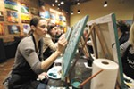 "Student Lisa Mularski works on a painting, ""Jasmine's Jade,"" during a class at Pinot's Palette."
