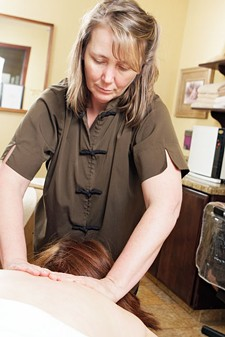 Student Massage Therapist Jennifer Molina practices Swedish Massage at the Highland Day Spa/American Institute of Clinical Massage in Post Falls. - YOUNG KWAK