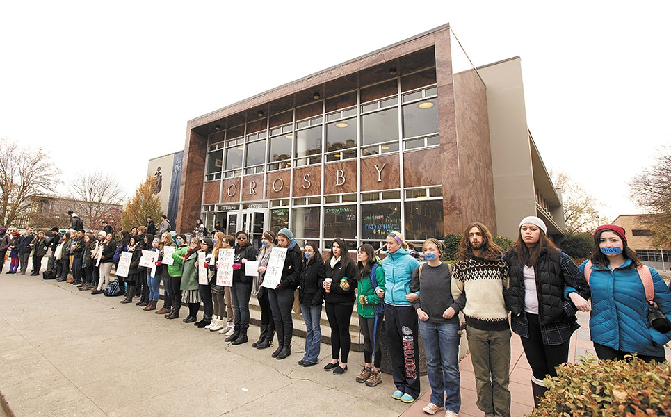 Students demonstrated in front of Gonzaga's student center to call for policy changes and draw attention to a national statistic that one in four college women have been raped. - YOUNG KWAK