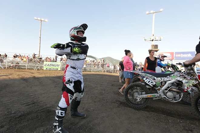 Sultan, Wash. 250 cc pro rider Ryan Abrigo stretches before a Moto 1 race. - YOUNG KWAK