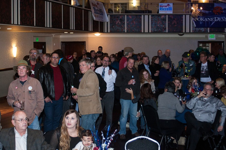 Supporters of Democratic candidates watch as the first election results are posted. - ASHLEY TOMLINSON
