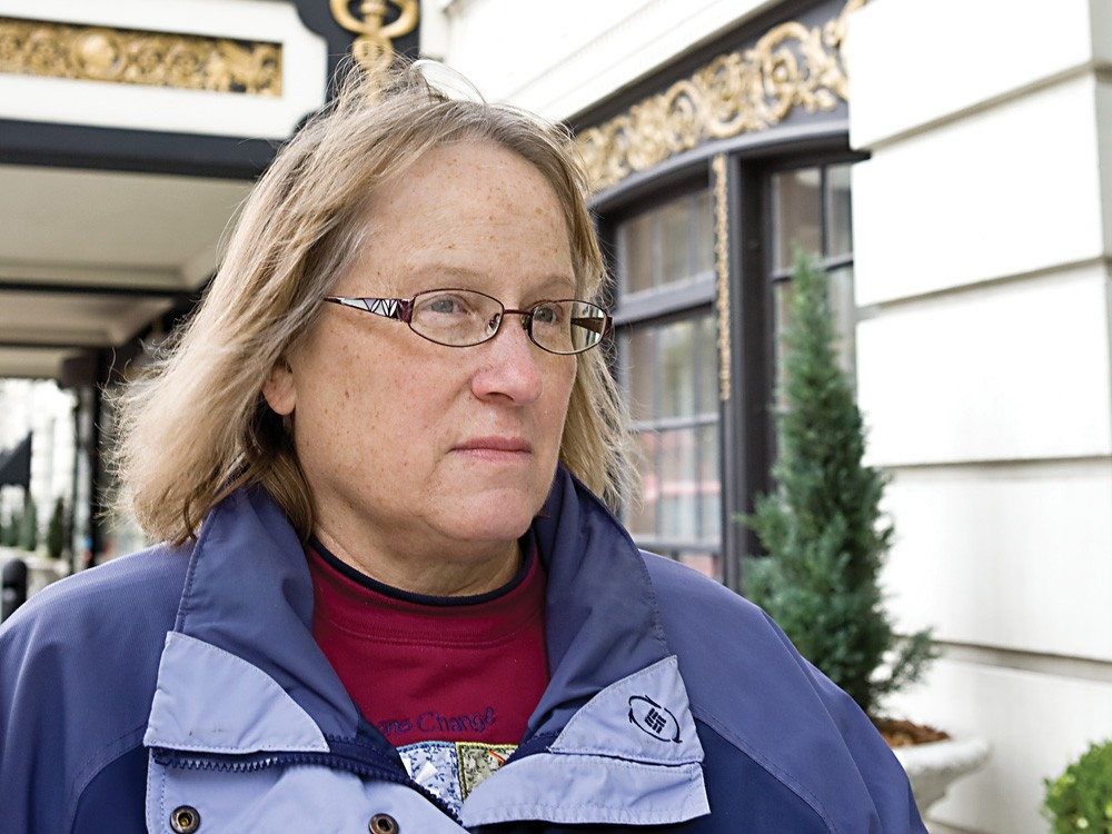 Susie Matteson stands in front of the Davenport Hotel, the epicenter of the Davenport Arts District. - STEPHEN SCHLANGE