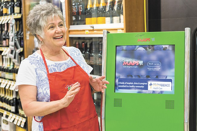 Suzie's Maps founder Suzie Willcox demonstrates how to use the kiosk in the South Hill Rosauers. - STEPHEN SCHLANGE