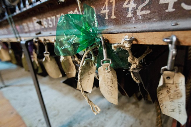 Tags attached to a backdrop pulley system in the Auditorium. - YOUNG KWAK