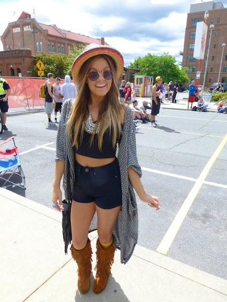 Taylor Halverson, Spokane native, watched some friends play while channeling her inner Coachella. - MADISON BENNETT
