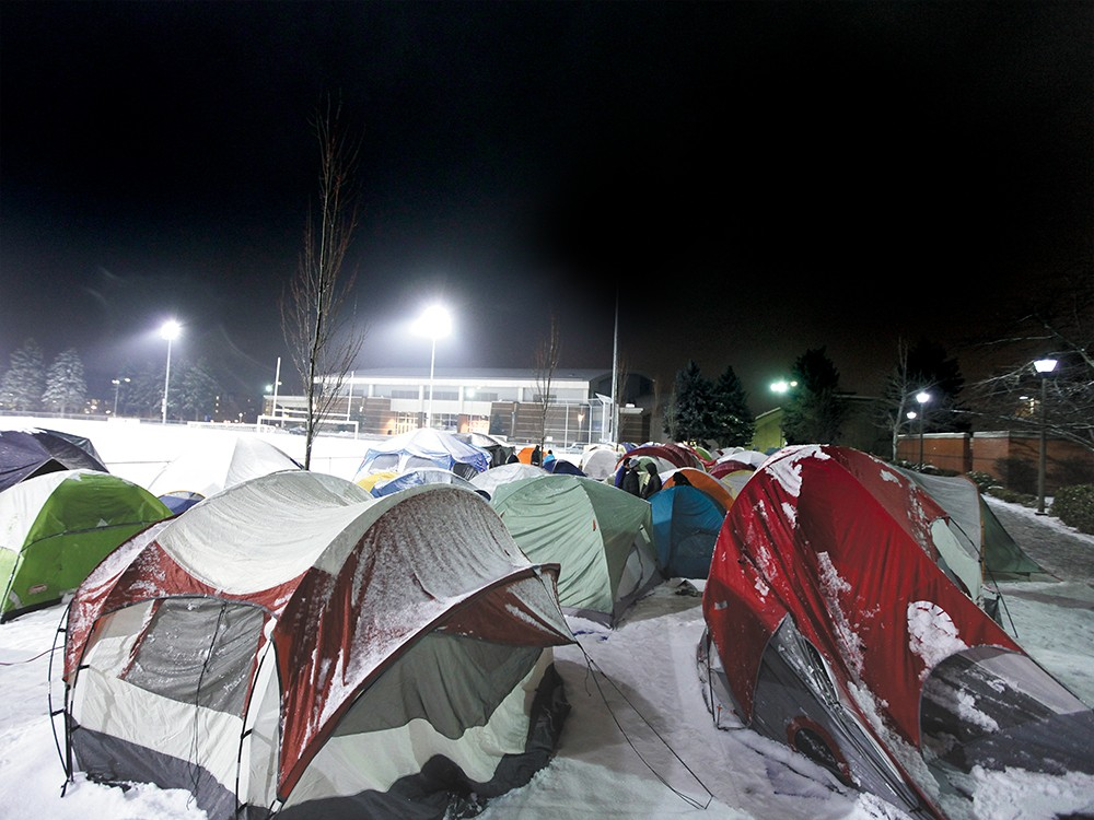 ""\""""Tent City,"""" as it's become known, is home to hundreds of Gonzaga students hoping to get close to the court for big games. - YOUNG KWAK""1000|750|?|en|2|6838cc6768ede85417b77ca140f4813d|False|UNLIKELY|0.3490946292877197
