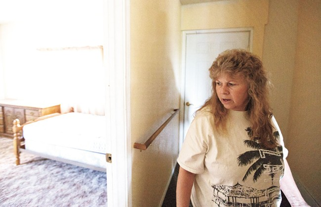 Terri Mayer walks through her empty group home. - YOUNG KWAK