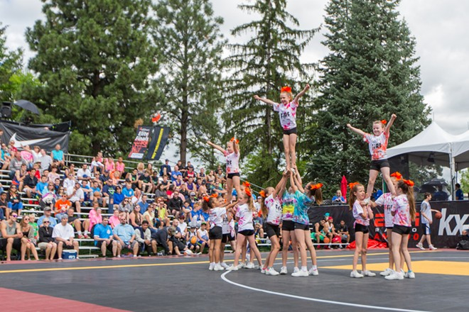 The 6-to-12-year-old age group of Built In Athletics performs at center court. - MATT WEIGAND