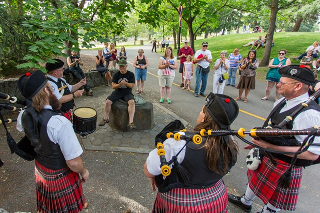 The Angus Scott Pipe Band of Spokane plays for people in Riverfront Park. - MATT WEIGAND