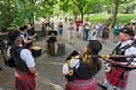 The Angus Scott Pipe Band of Spokane plays for people in Riverfront Park.