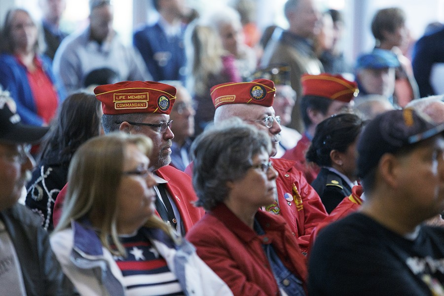 The audience, including veterans, listen to speakers during a Veterans Day Ceremony. - YOUNG KWAK