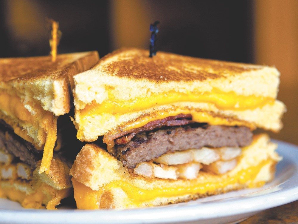 The Billy Breen burger uses grilled cheese sandwiches for buns. - STEPHEN SLANGE