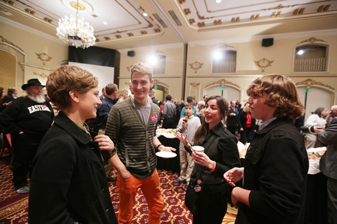 The children of Spokane County Clerk Timothy Fitzgerald (R), not pictured, Erin Fitzgerald, left, Meghan Fitzgerald, second from the right, 15 year old Kellen Fitzgerald, right, speak with Scott Mackay. - YOUNG KWAK