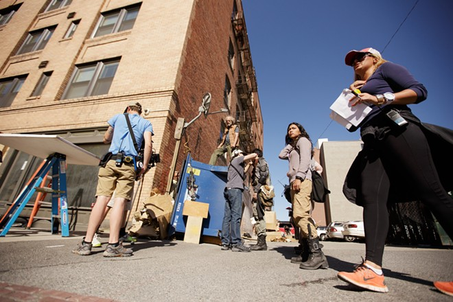 The crew, including 1st Assistant Director Esther Dupree,  prepare to film a scene. - YOUNG KWAK