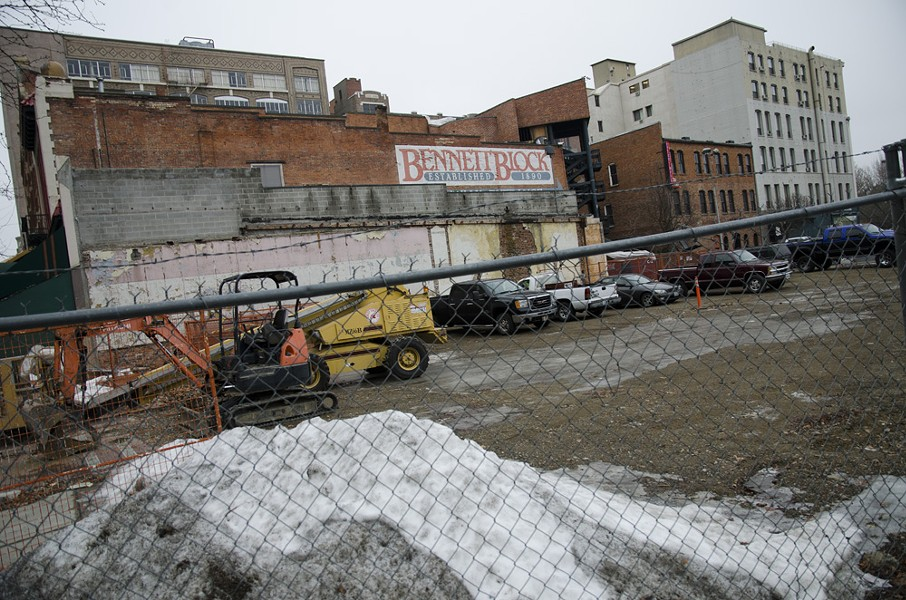 The east side of the Bennett Block has been an empty lot since Cyrus O'Leary's was demolished. The whole block will see big changes in the coming months. - LISA WAANANEN