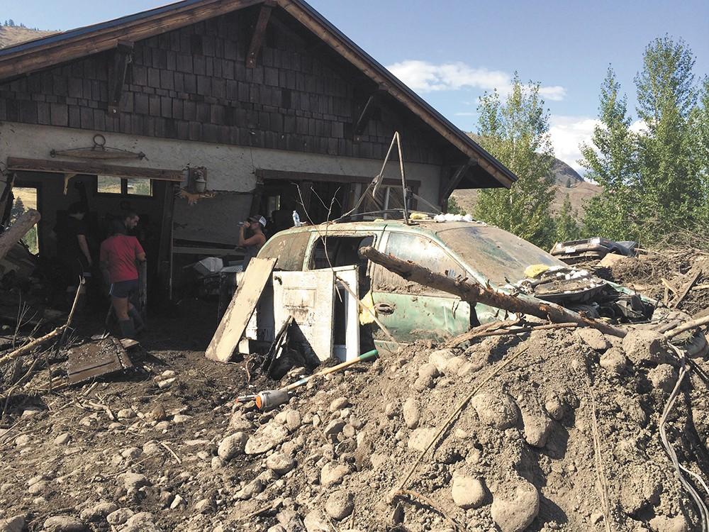 The garage of Bob Elk Belgard and Janie Lewis. - SCOTT A. LEADINGHAM