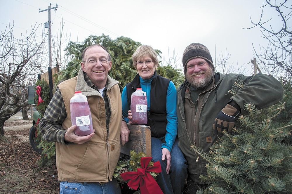 The Hansens — Rod, Karen and Derrick Hansen, from left — have been growing apples on Green Bluff for three decades. - SARAH WURTZ