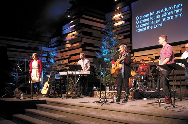 The Long family, (left to right) Meghan, Curran, BethAnn, Riley, Colin and Bill sing together at Summit Church. - SAMUEL SARGEANT