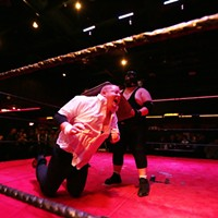 Spokane Anarchy Wrestling at Swaxx The Masked Juggalo takes a baking pan to Hollywood Donovan Etzel.