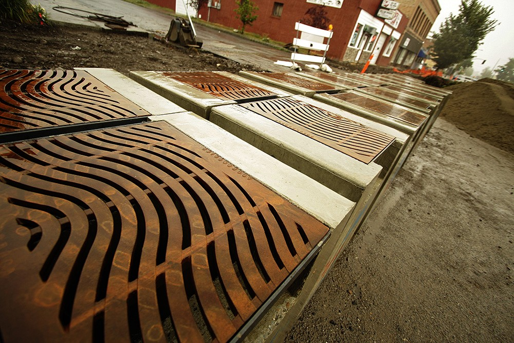 The new plan to clean up the Spokane River includes design features like this stormwater collection project constructed in 2010 on West Broadway Avenue. - YOUNG KWAK