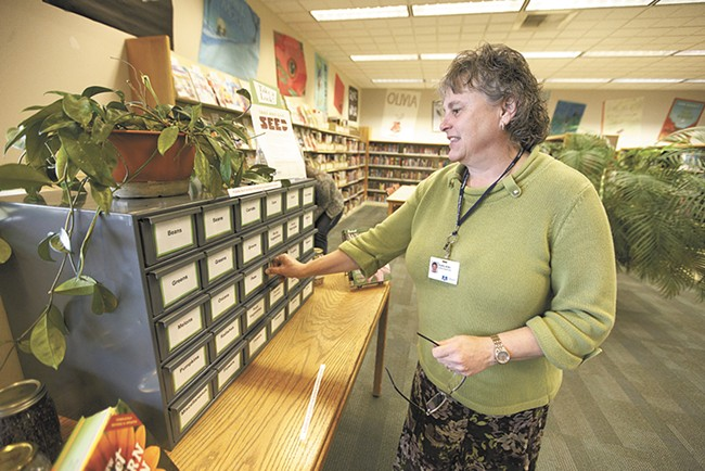 The Otis Orchards seed library has lent hundred of seed packets since launching in February with the help of supervisor Kathy Allen. - YOUNG KWAK