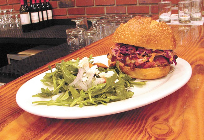 The pulled pork sandwich pairs well with the beer at Daft Badger. - CARRIE SCOZZARO