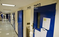 "The row of cells used for inmates on ""suicide watch"" at the Spokane County Jail. The ""30"" magnet on the cell door indicates the inmate must be checked on every 30 minutes. - JACOB JONES"